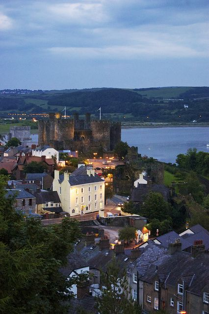 """Conwy Castle at night. The lights over the estuary are those of Llandudno Junction, and off to the right of those is the area known as """"Llansanffraid Glan Conwy"""". rjp"""