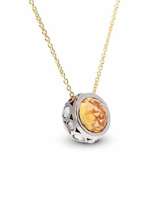 Jewelry designed by Selim Mouzannar: White sapphires pendant with yellow and white gold.