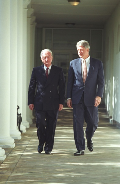 Photograph of President William (Bill) J. Clinton and Prime Minister of Israel Yitzhak Rabin Walking Along the Colonnade of the White House, 11/12/1993