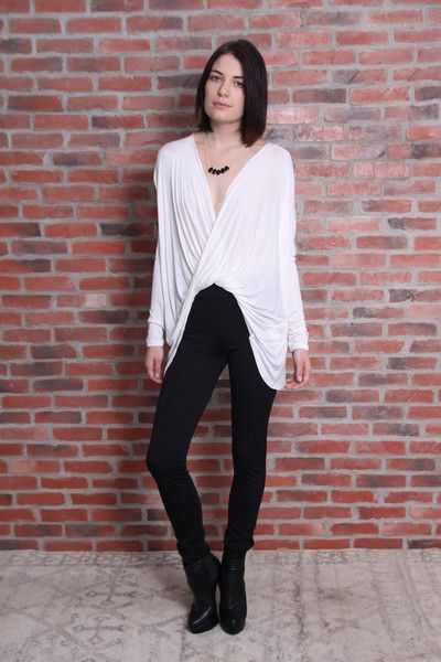 Twist Top Twisted front, long sleeve top. Featuring a deep v-neck and hi lo hem. Accentuate with your favorite statement piece, like Ell and Emm's Mini Audrey necklace.