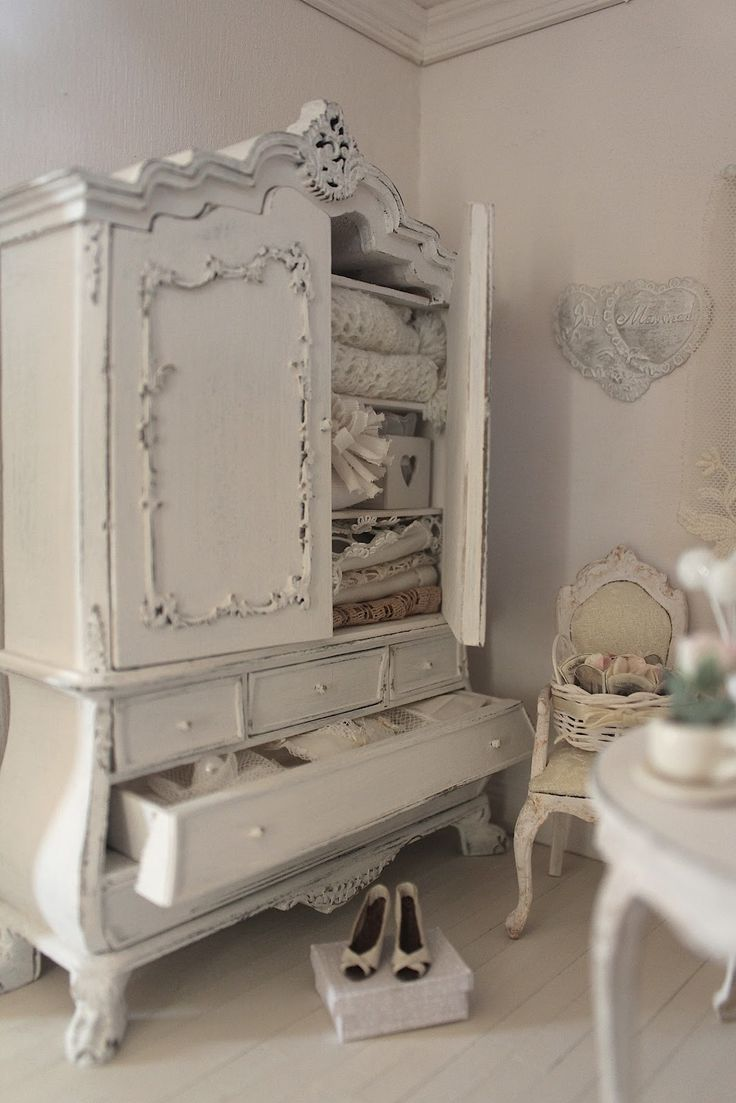 White painted distressed antique French Armoire