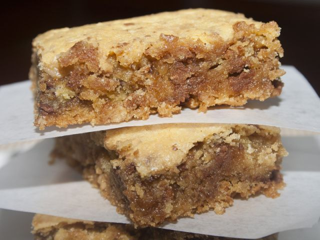 Lazy Heath Bars: - 1 box yellow or white cake mix (15 ounce box) - 2 eggs beaten - 5 T melted butter - 2 C Heath toffee bits, M&M's or mini chocolate chips   Melt butter. Allow to cool slightly then add cake mix (dry), eggs and toffee bits (or whatever you are using). Press into a greased 9×13 pan and bake at 350 for 20-25 minutes.