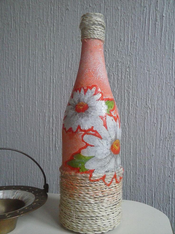 Botella con decoupage y lazo.