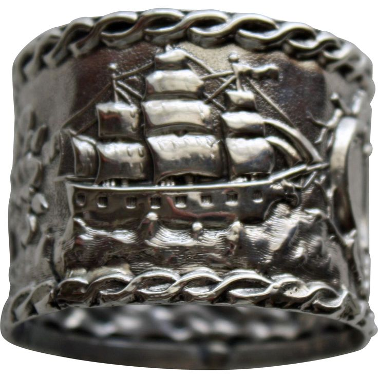 This wonderful coin silver napkin ring is a testament to the United States with symbols to remind us of our great country. On the ring is a large