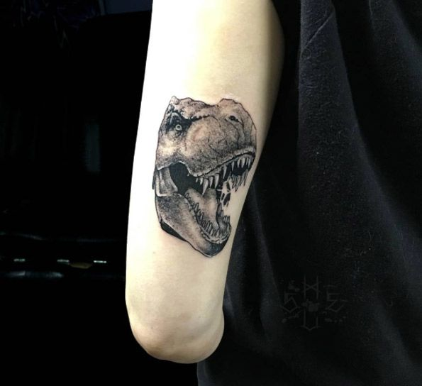 Blackwork t-rex head on back arm by Anton