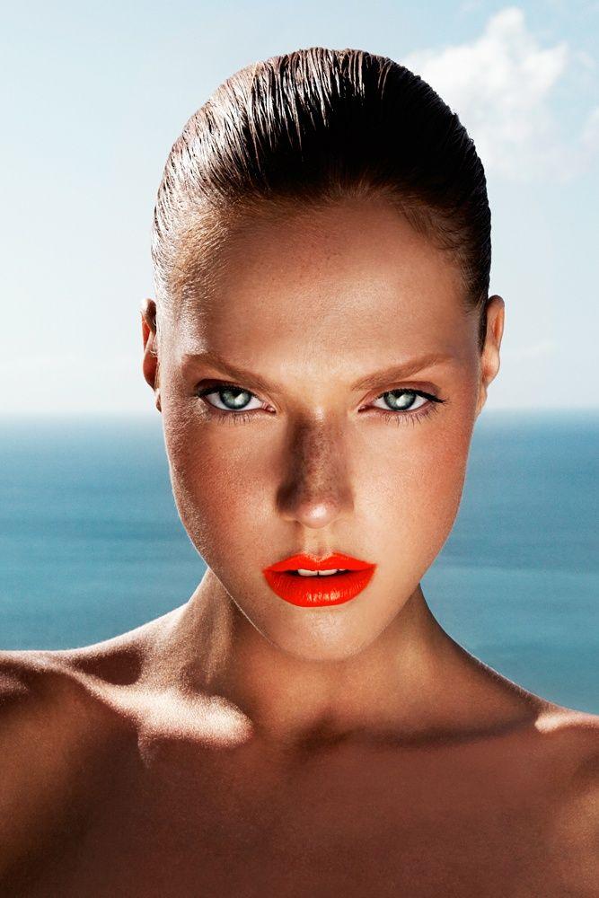 Glossy orange lips