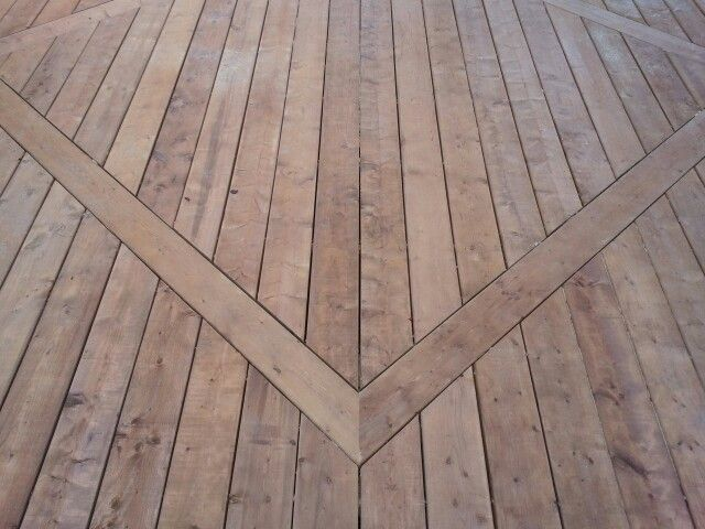 Creating a diamond inlay for this roomy new deck breaks up for Brown treated deck boards