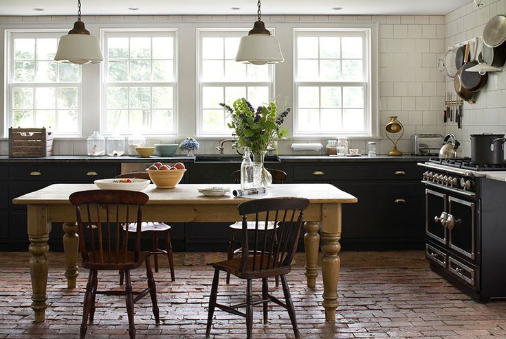 "antique farmhouse remodeled with great freshness-love the brick floor, no upper cabinets-great ""unfitted"" look!"