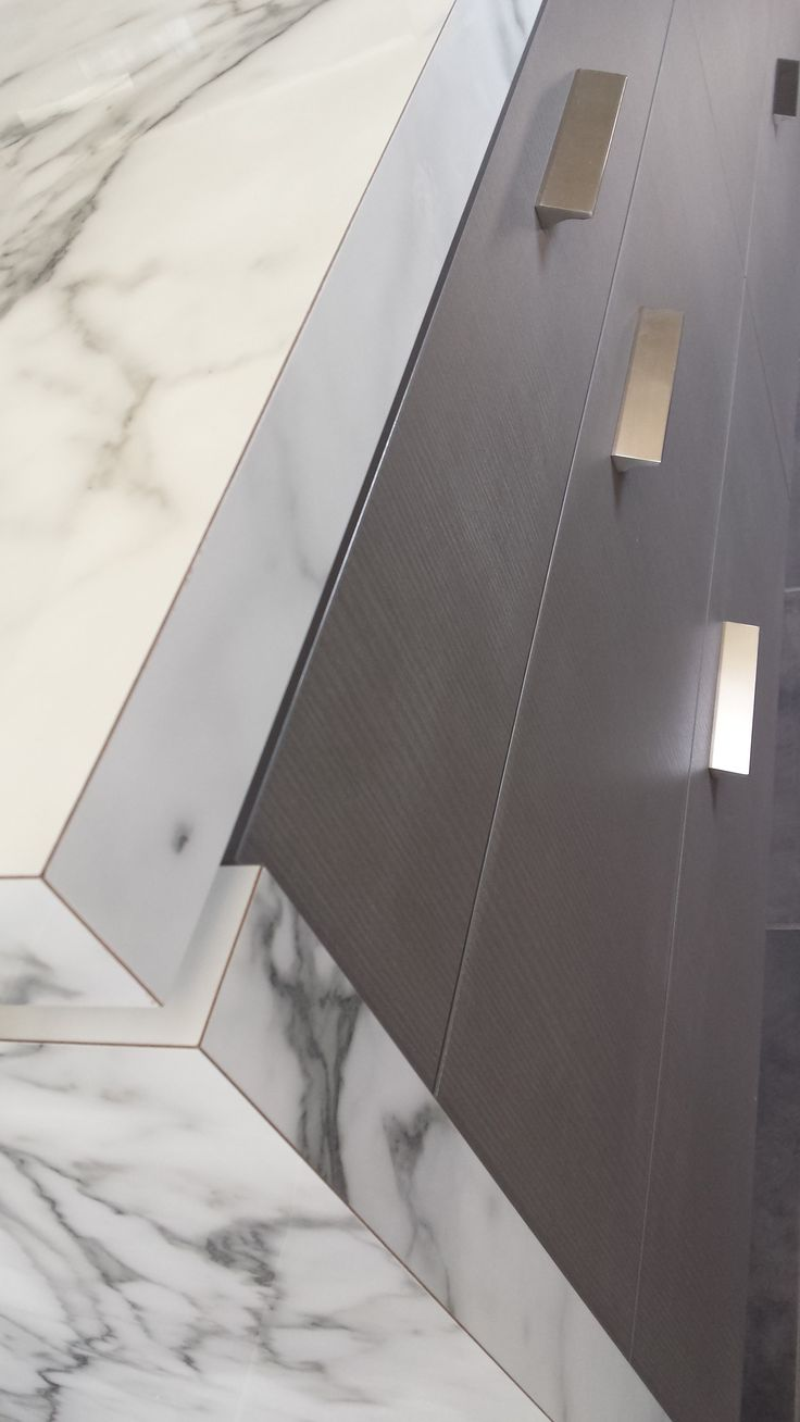 """We used some new products from Laminex in our latest """"Spec Home"""" located at 7 Pearl Street Cannonvale which is also available for Sale.Bench tops - new from Laminex in the Diamond Gloss finish """"Carrera Marble"""". For the cabinetry we used Laminex Nuance Finish """"Moose""""."""