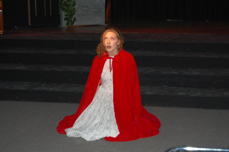 Phantom of the Opera...Christine in her cape visiting her fathers grave.