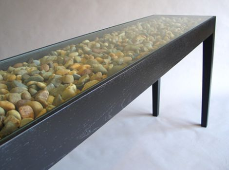 Bed of gravel or stone inside a console table. On its own or use as a display case