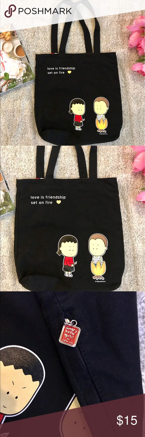 "Angry Little Girls Tote Adorable tote in black. Tote measures 22"" long including strap. Few white stains in the back all show in pictures. angry little girls Bags Totes"