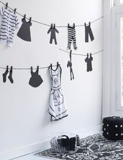 Stencil a clothesline and add some real clothes for an adorable retail display!