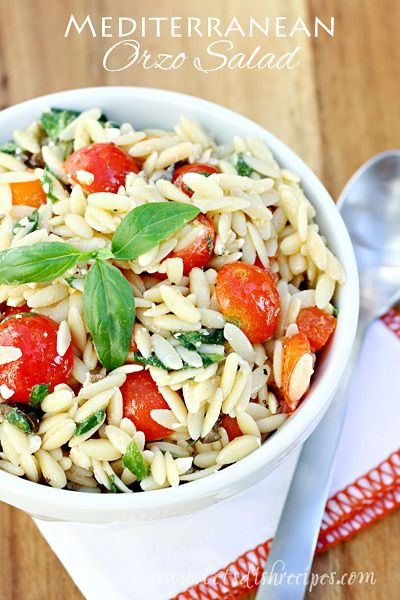 Mediterranean Orzo Salad | This light pasta salad is loaded with spinach, tomatoes, olive, peppers and feta cheese, with a vinegar and oil dressing.