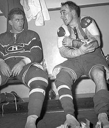 """Maurice Richard (left) sits beside Toe Blake. The pair, along with Elmer Lach, comprised the """"Punch line"""" in the 1940s."""