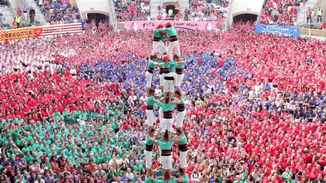 In the city of Tarragona, Spain, castellers gather every two years to see who can build the highest, most intricate human castles. This Catalan tradition requires astonishing strength, finesse, and balance. Not to mention courage. (see article: http://www.gadling.com/2012/06/04/video-of-the-day-human-towers-in-tarragona-spain/?a_dgi=aolshare_facebook  )