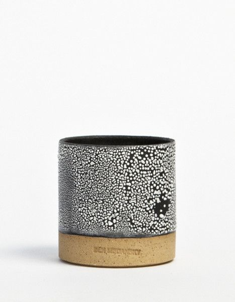 'Cup, White Braille on Black' (2014) by LA-based American sculptor Ben Medansky. Ceramic. via the artist's site