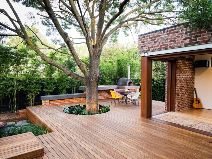 This imaginative configuration incorporates trees, bamboo, walkways, an outdoor oven and decking made from Yellow Stringybark into a natural open space by COS Design. Landscape by Signature Landscapes.
