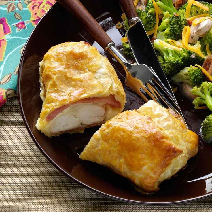 """Easy Chicken Cordon Bleu Recipe -""""Cordon Bleu"""" is of French origin meaning """"blue ribbon""""—given as a prize for culinary excellence. The term also refers to a signature dish of chicken topped with a slice of ham and Swiss cheese, usually breaded and sautéed, or in this case, wrapped in puff pastry for a quick and easy finish. —Sharon Laabs, Hartford, Wisconsin"""