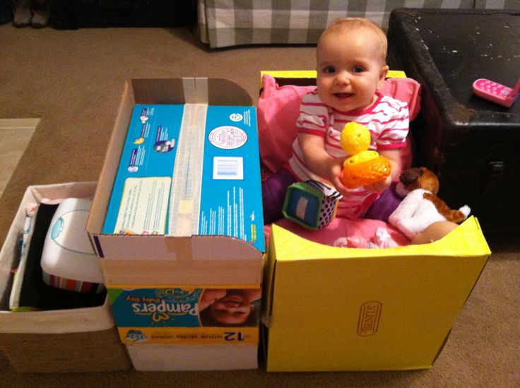 Spica cast desk. We made the little desk with the rim around it out of an old diaper box so that she could put toys next to her and play while in the spica cast.