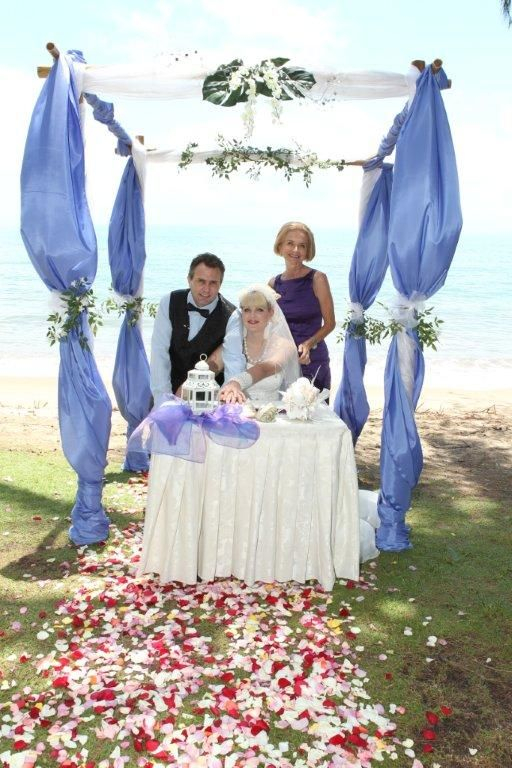 Tropical arbour  at Palm Cove Beach by www.barefeetweddings.com.au
