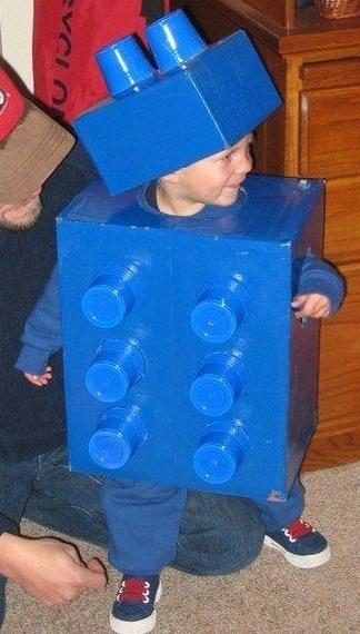Cool Lego costume. All you need Is a cardboard box and solo cups an easy Halloween costume for kids.