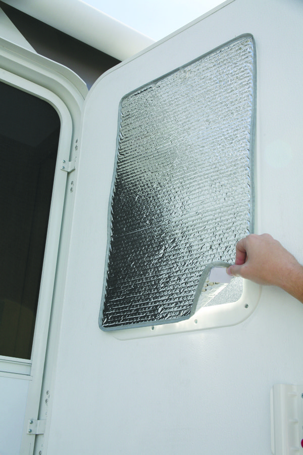 """DIY with a bit of sewing skills. :)  Camco 45167 Reflective Door Window Cover Solar Door Shade Camper Trailer RV  Shade reduces heat loss in the winter and reflects sunlight to keep out heat in the summer. Installs easily with Velcro tabs - included.  16""""W x 24""""L. 1 per pack.  $8.49"""