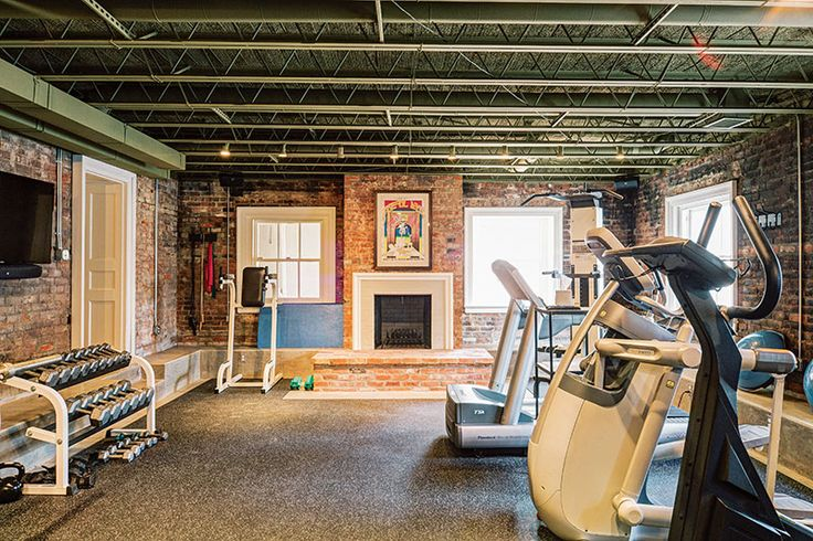 "The basement, originally populated by the ""downstairs"" staff, was cleared of massive industrial-sized mechanical equipment and re-tooled as home gym extraordinaire with weight room, cardio room, and hot yoga space. Two original silver safe doors were left in place as vestiges of the estate's golden age heyday."