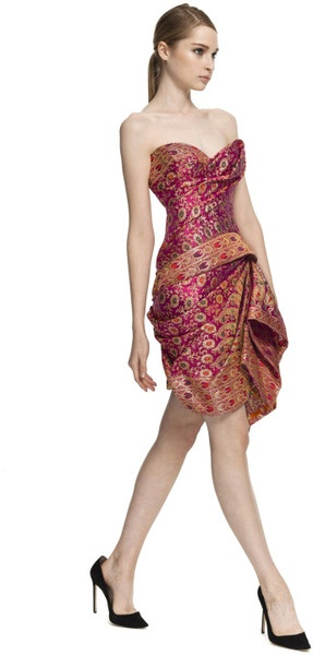 Marchesa Strapless Sari Cocktail Dress This strapless sari cocktail dress features a hand-draped sweetheart bodice and a draped wrap-style skirt. Back zip. 100% antique silk. Partially lined. Made in USA.