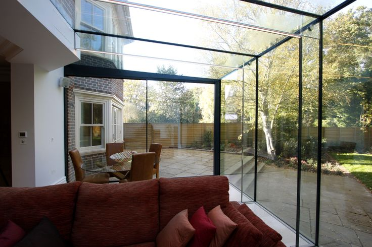 Minimal windows sliding doors were used as the rear access for Sliding glass doors extension
