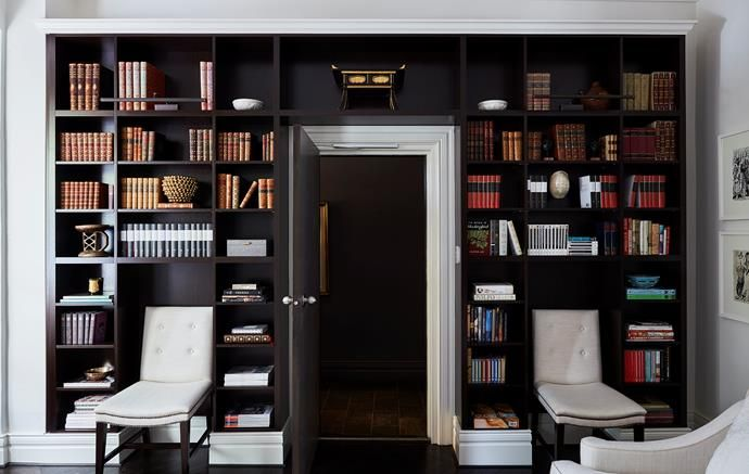 Custom-joinery creates a clever use of space in this small apartment and makes for a magnificent home library. | Story: Belle