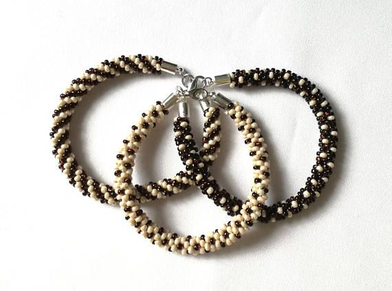 For different sizes or colors, please contact me at linda@mymemet.com.  Handmaded Beaded Bracelate  - the pendant is made of Czech beads - the technique used is Kumihimo. - color used are beige and brown  - pendants length is: 8.46 inches / 21.5 cm; widith: 0.19 inches / 0.5 cm The pendant is delivered in an organza jewelry bag.  It is a great gift idea, a birthday or anniversary present.
