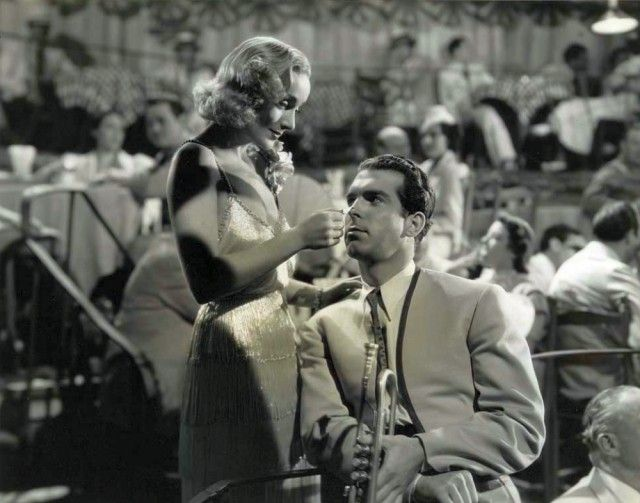 "Skid Johnson (Fred MacMurray): ""How about meeting me on the dock, under the moon?"" // Maggie King (Carole Lombard): ""What if there isn't a moon?"" // Skid Johnson: ""I'll meet you under the dock!"" -- from Swing High, Swing Low (1937) directed by Mitchell Leisen"