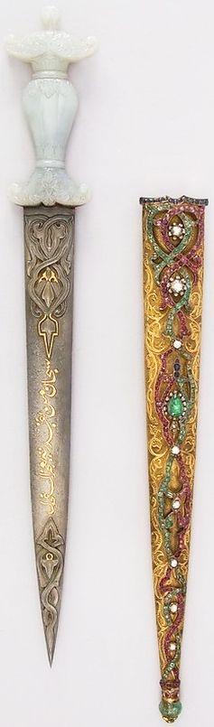 Ottoman dagger, 19th century, steel, gold, jade, diamond, sapphire, ruby, emerald, L. with sheath 17 9/16 in. (44.6 cm); L. without sheath 15 15/16in. (40.5 cm); L. of blade 11 3/16 in. (28.4 cm); W. 2 5/16 in. (5.9 cm); D. 3/4 in. (1.9 cm); Wt. 9.7 oz. (275 g); Wt. of sheath 5.3 oz (150.3 g), Met Museum.