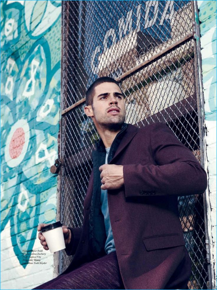 Enjoying a cup of coffee, Chad White dons a Zachery Prell jacket and T by Alexander Wang t-shirt with a Todd Snyder coat and pants.