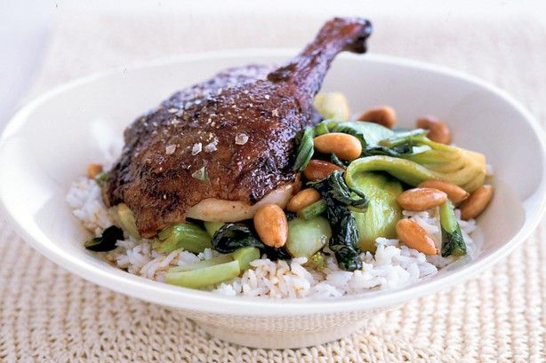 Spicy szechuan duck is served traditionally with steamed rice.