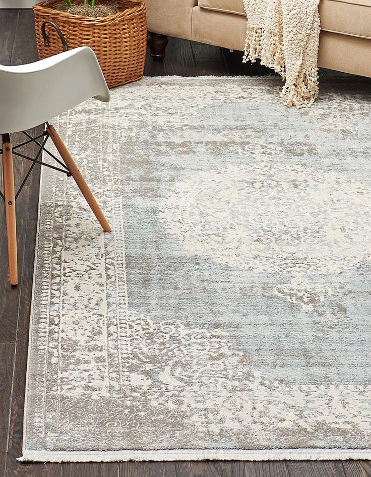 "This Turkish New Vintage rug is made of 85% polypropylene, 15% polyester with 100% cotton backing foundation for extra durability and ultra softness. This rug is easy-to-clean, stain resistant, and does not shed. Colors found in this rug include: Light Blue, Ivory, Gray. The primary color is Light Blue. This rug is 1/2"" thick."