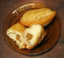 Panada snack in Indonesia In Indonesian cuisine, a panada is a bread snack filled with spicy tuna or cakalang fish (skipjack tuna). It is derived from the Portuguese empanada. It is the specialty of Manado city, Minahasa people, North Sulawesi, Indonesia.
