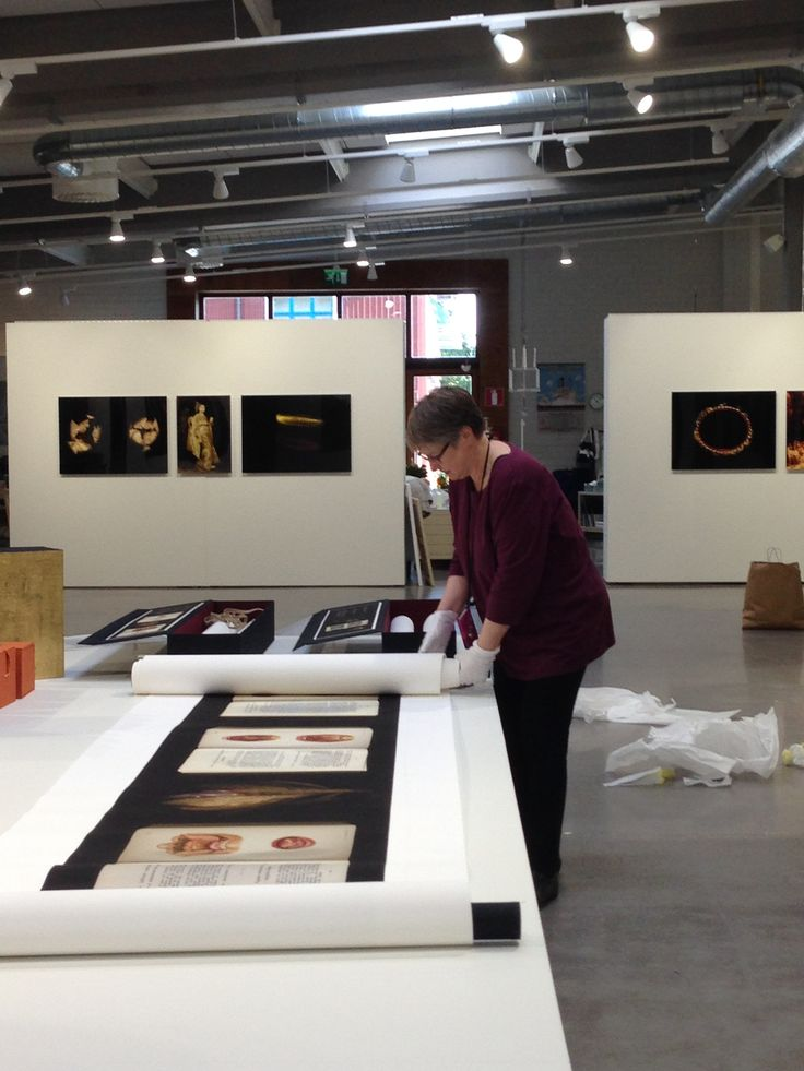 Artist Anita Jensen at work, getting ready for her exhibition opening.