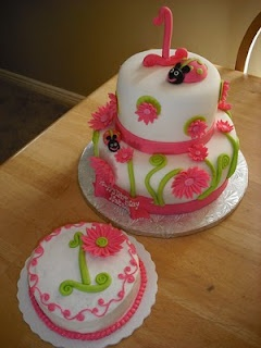 Pink ladybug cake for a 1st birthday party.  Great to have an individual cake for the guest of honor. :)