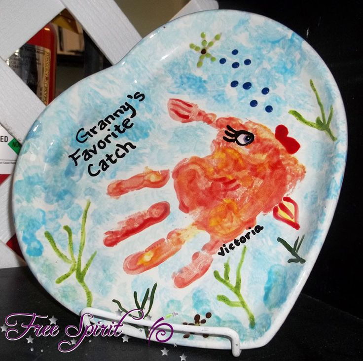 Awesome handprint fish pottery painting free spirit for Handprint ceramic plate ideas