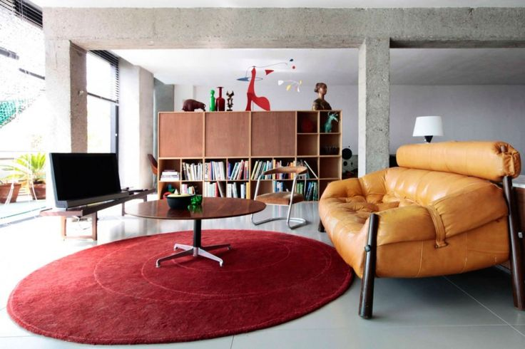 Loft: Spacious Pallars Loft Interior with Minimalist Style in Barcelona, Spain by KAYSERSTUDIO, Stylish Pallars Loft Living Room Decorating Idea showing Tufted Leather Sofa and Round Top Coffee Table and Red Round Area Rug also Antique Bookshelf Unit