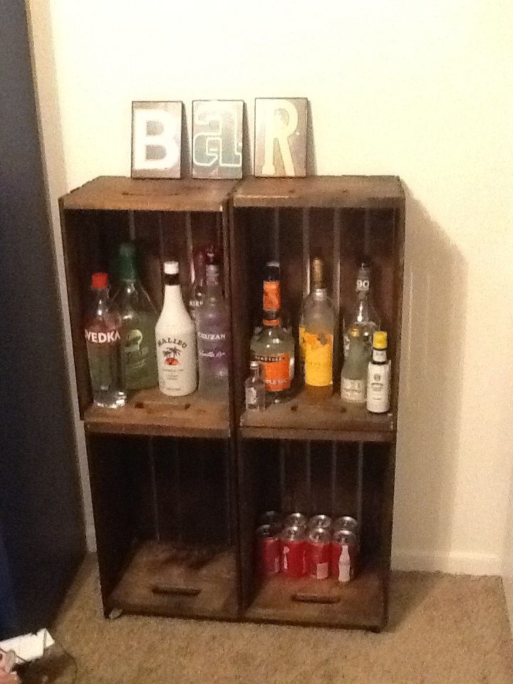 DIY Bar- from the largest crates at Michaels. Stained them and attached them together with brackets. Added castors at the bottom, made for the perfect bar, in my tiny apartment.