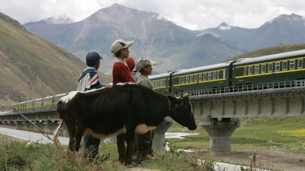 Beijing to Lhasa: This two-night trip covers nearly 4000 kilometres, takes in the world's highest railway line and the world's highest station. A Train from Lhasa Railway Station travels on the Tibetan grasslands near Lhasa, Tibet.