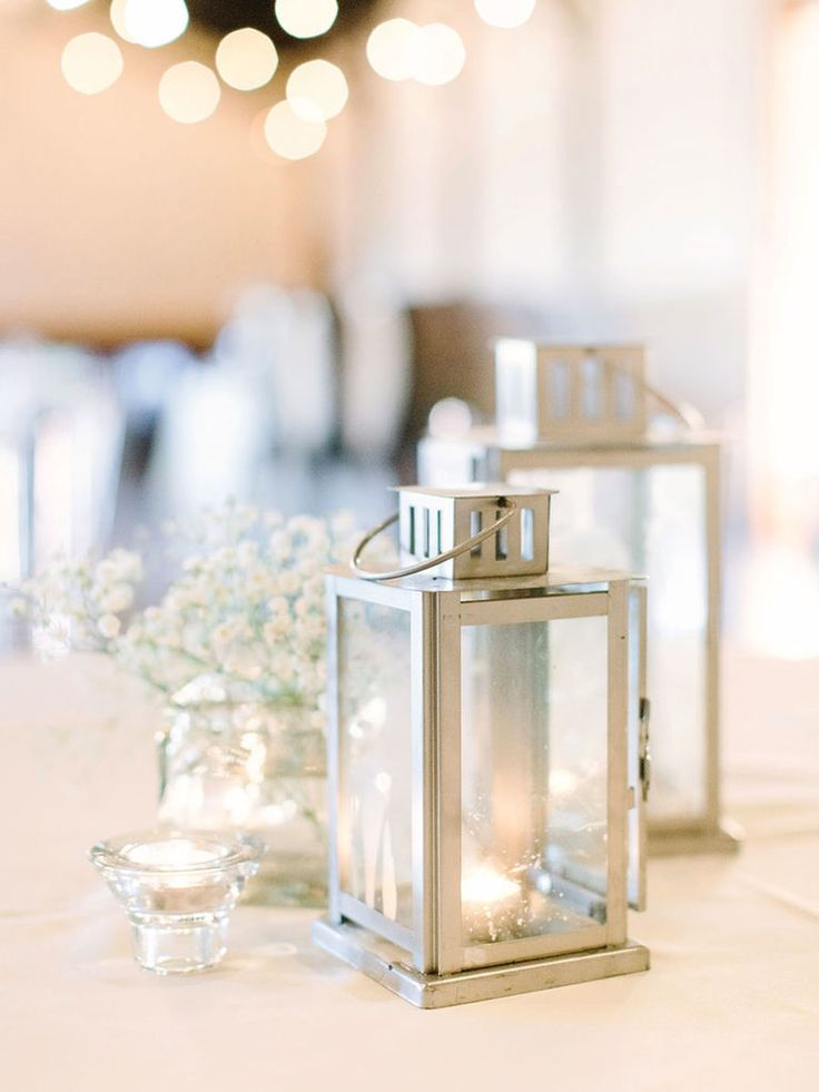 Sometimes less is more. Silver lanterns with a bit of baby's breath are the perfect addition to your table setting for a sleek and simple centerpiece.