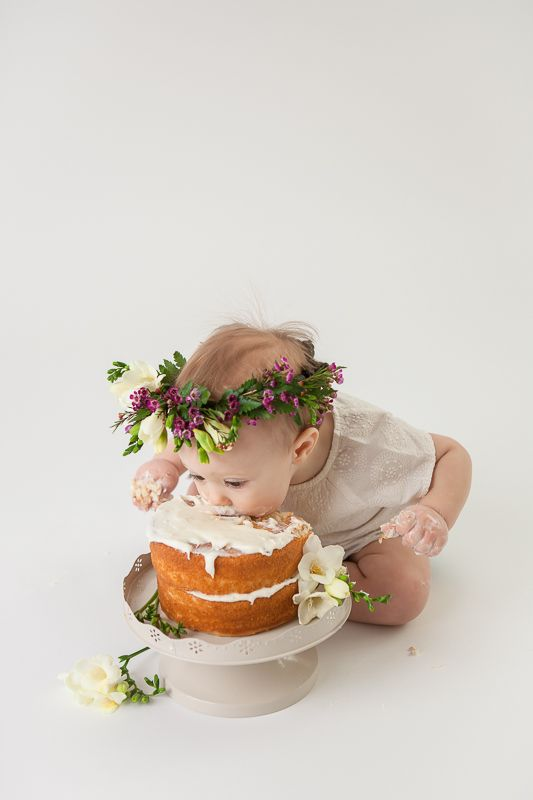 Unique baby photography of your little one in a milk bath, rocking a cake smash, or just being plain cute. Parents, siblings and pets are welcome!