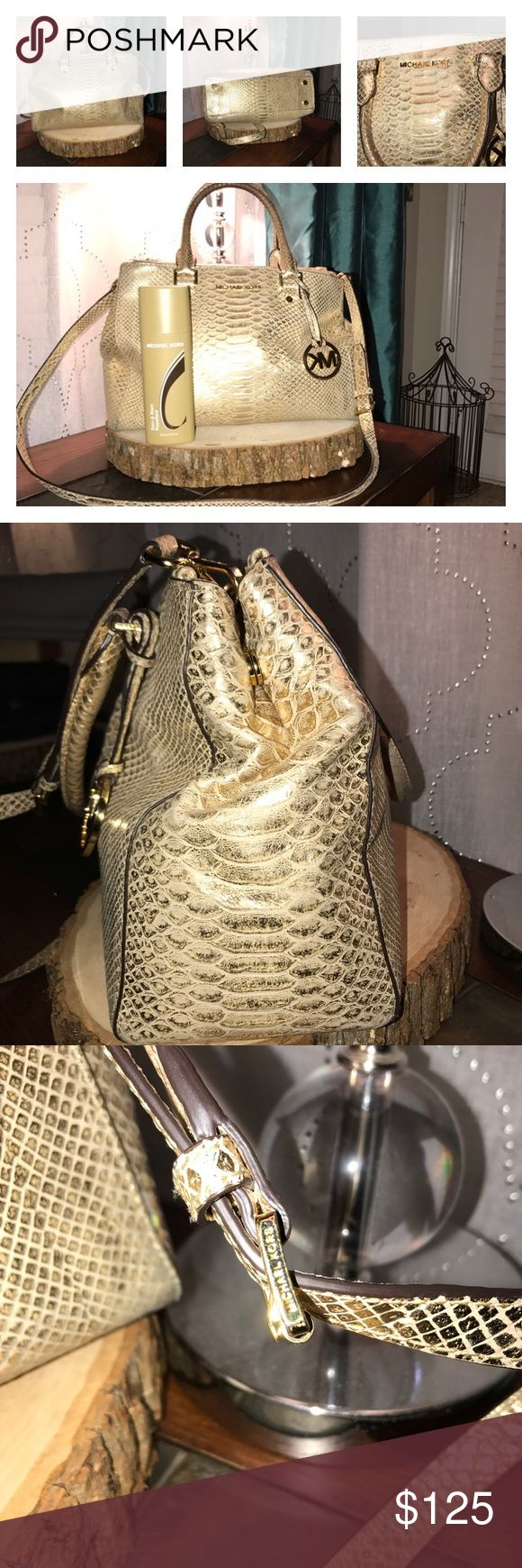Micheal Kors Gold Metallic Purse Used gold metallic authentic MK purse purchased from Michael Kors store. MK rain & stain repellent spray included with purchase of this purse. Handles of purse and bottom corner of purse shows visible wear. Inside of purse has some ink stains. Michael Kors Bags Shoulder Bags
