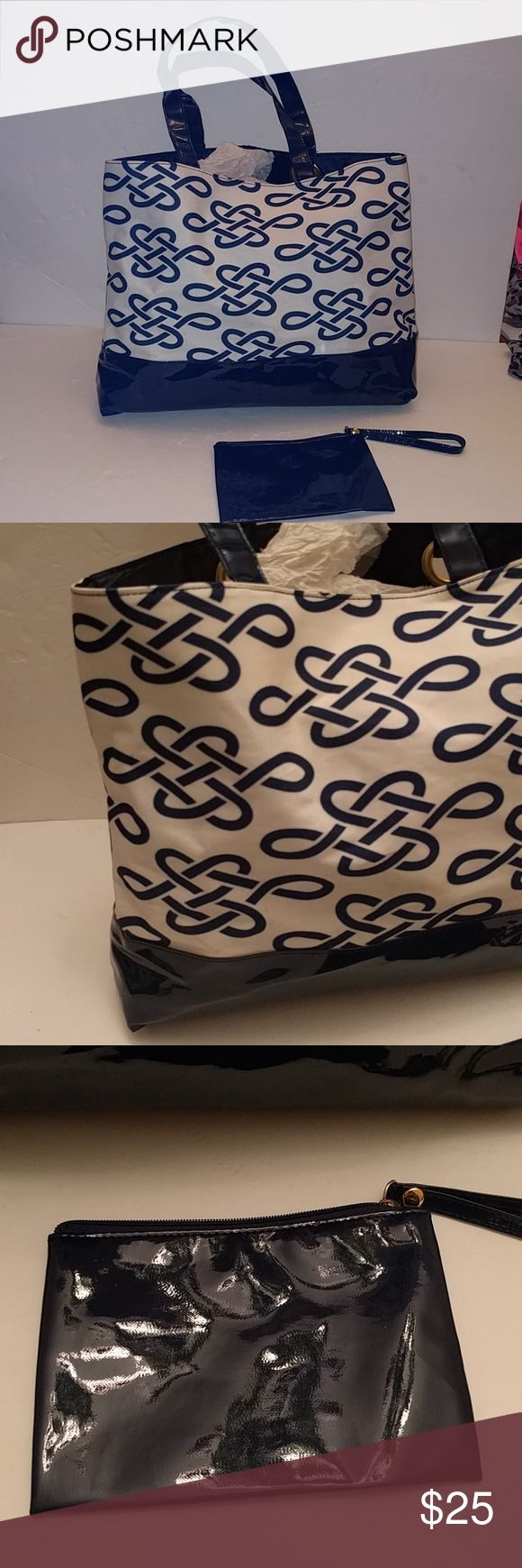 Estee Lauder celtic knot blue and white tote bag Good condition, small spots of wear both pictured. This tote is 15 inches wide and 11.5 inches tall. Comes with a shiny navy wristlet Estee Lauder Bags Totes