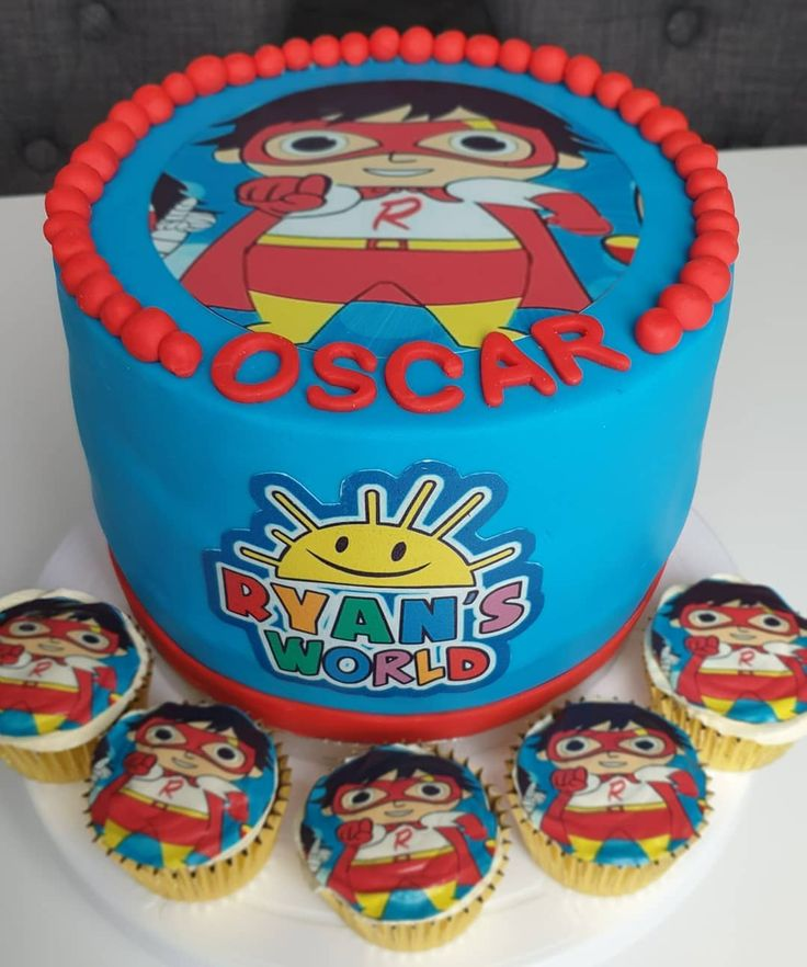Ryans toy review cake with matching cupcakes .