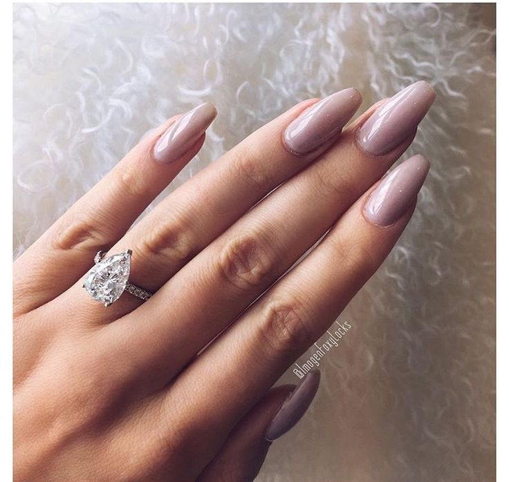 Gorgeous ring and nude nails
